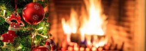 Christmas tree on burning fireplace background